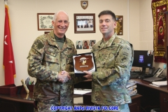 Columbian Jumpmasters formally thank Maj. Gen. David Ammerman, commanding general of United States Army Civil Affairs and Psychological Operations Command (Airborne) in Fort Bragg N.C. Dec 12, 2015. On behalf of USACAPOC(A), Ammerman also showed appreciation by thanking them for participating in Operation Toy Drop 2015. (U.S. Army photo by Pfc. Khadijah Wilcox/Released)